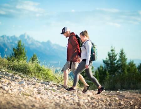 couple hiking snow king mountain