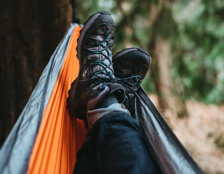 hiking-shoes-crossed-in-hammock