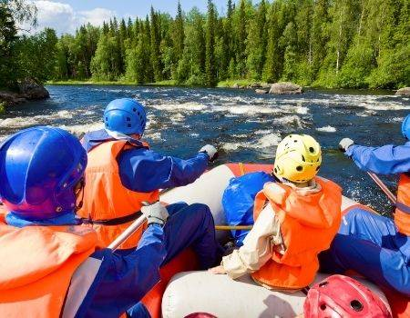 Whitewater rafters in a boat on a mountain river.