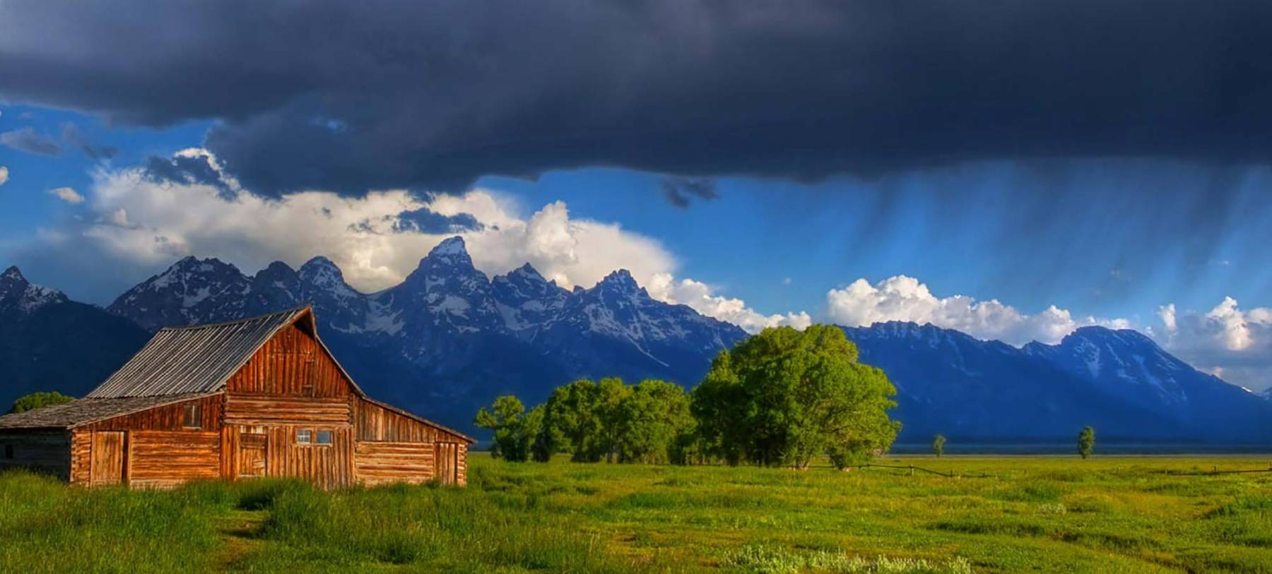 stormy sky over moulton barn jackson hole
