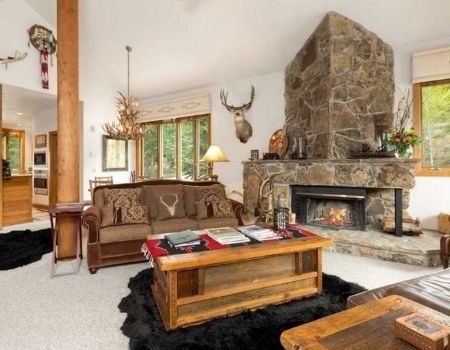 Mountain home living room with western decor and fireplace.