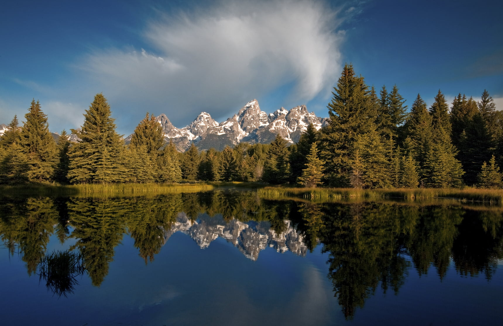 reflection of the grand teton in jackson hole